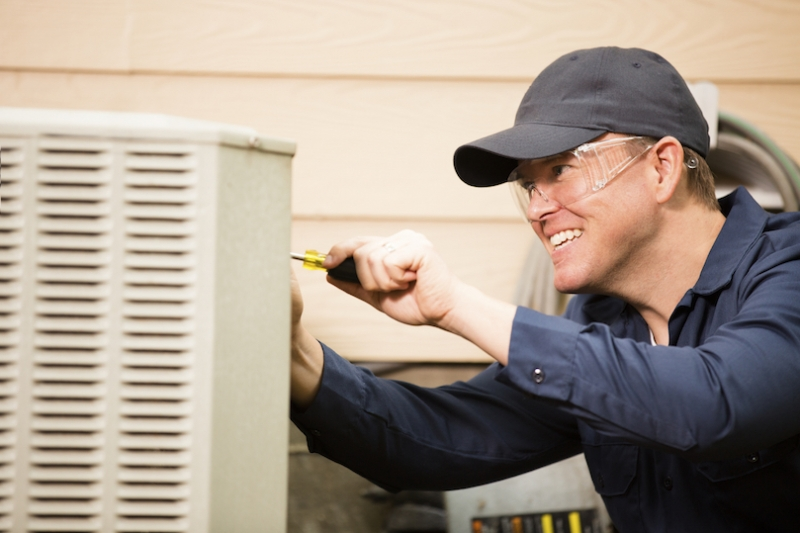 Technician working on a hvac unit
