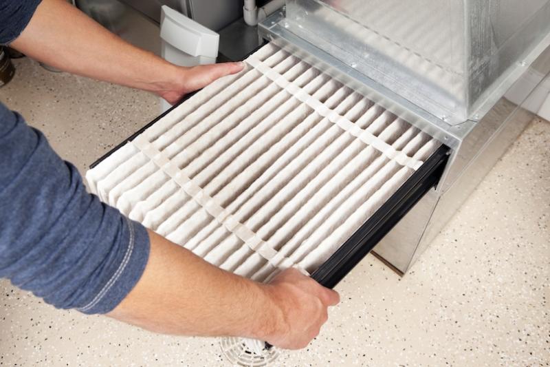 Man changing air filter