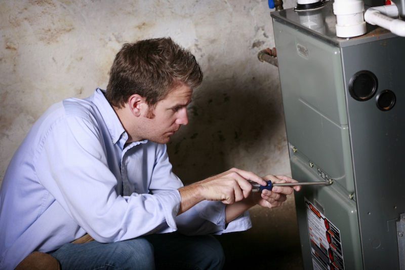 Technician doing furnace maintenance