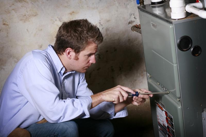 Technician doing furnace maintenance