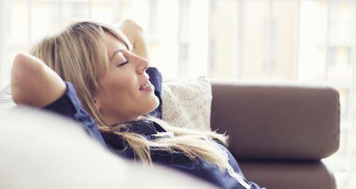 Woman enjoying air conditioning