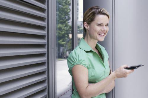 Woman next to window