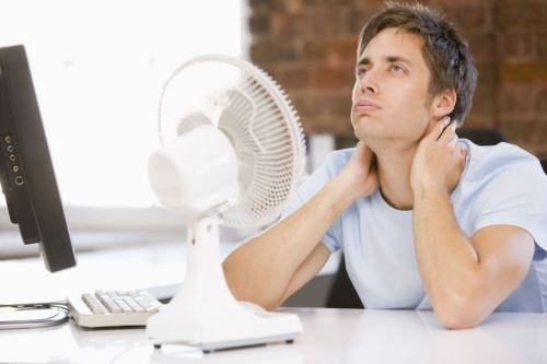Man cooling off at home