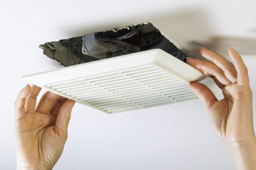 professional checking bathroom ventilation fan