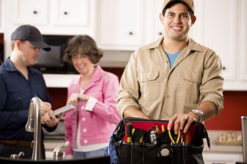 Smiling repair service technician